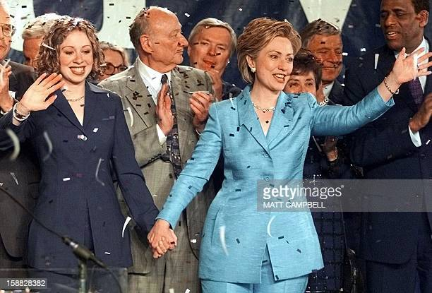 US First lady Hillary Rodham Clinton and daughter Chelsea Clinton wave to supporters before former New York mayor Ed Koch following Mrs Clinton's...