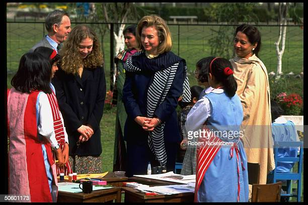 First Lady Hillary Rodham Clinton and daughter Chelsea, visiting a college for girls in Islamabad, Pakistan.
