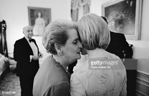 First Lady Hillary Rodham Clinton and Secretary of State Madeleine Albright are photographed before a White House state dinner on February 5 1998 in...