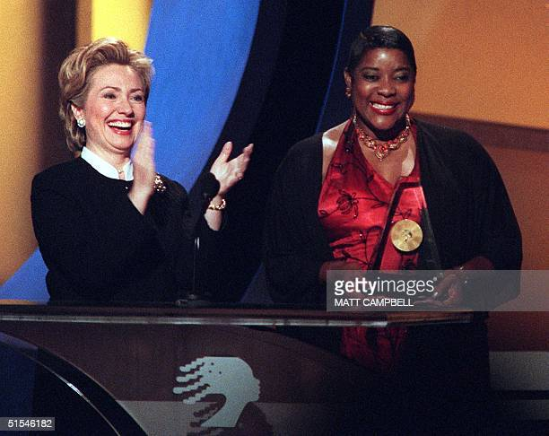 First Lady Hillary Rodham Clinton applauds as she and actress Loretta Devine introduce Mayor Emma Gresham for an Essence Award during the 2000...