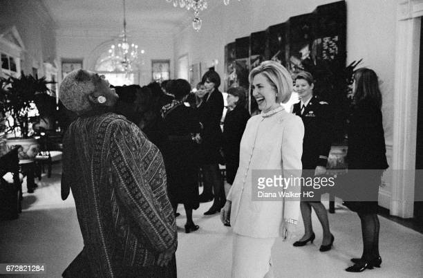 First Lady Hillary Rodham Clinton enjoys a laugh with Elaine Jones president and directorcounsel of the NAACP Legal Defense Fund at a luncheon...