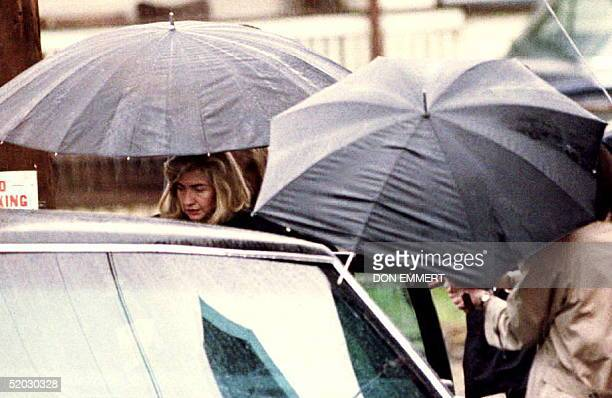 S First Lady Hillary Rodham Clinton enters the presidential limousine as she leaves the Court Street United Methodist Church 10 April 1993 after...