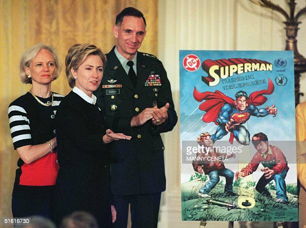 First Lady Hillary Rodham Clinton Hattie Babbit deputy director of the US Agency for International Development and Lt General Michael Davison of the...