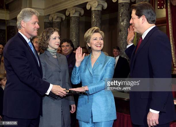 First Lady Hillary Rodham Clinton is sworn in as a US Senator by Vice President Al Gore with her husband US President Bill Clinton and daughter...