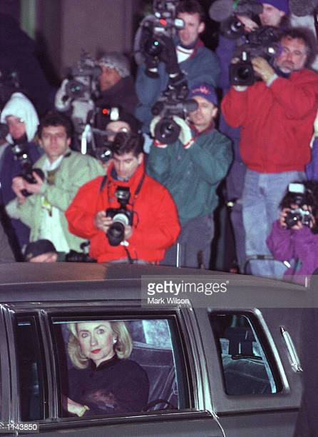 First Lady Hillary Rodham Clinton looks out at reporters as she departs from the US District Court in Washington Friday Jan 261996 where she...