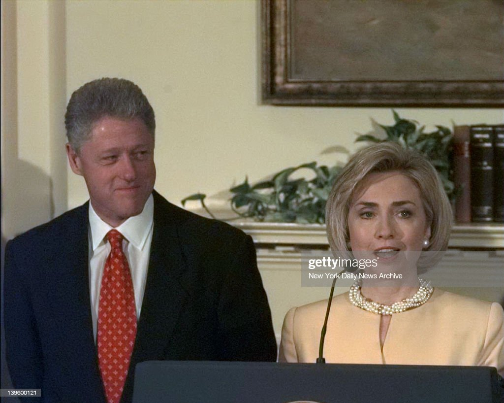 First Lady Hillary Rodham Clinton stands by the President, her husband Bill Clinton as he denies improper behavior with Monica Lewinsky, in the White House Roosevelt Room. 'I did not have sexual relations with that woman,' Clinton said.