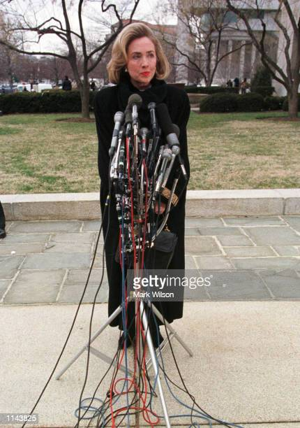 First Lady Hillary Rodham Clinton talks to reporters as she arrives at the US District Court in Washington Friday Jan 261996 where she was to testify...