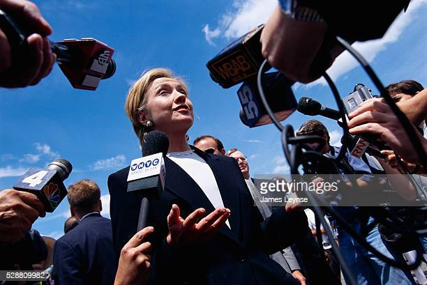 First Lady Hillary Rodham Clinton talks to the press and beachgoers at Jones Beach in New York