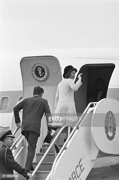 First Lady Jackie Kennedy waves goodbye to her children as she and the President board a plane for Dallas on November 21 1963 The next day the...