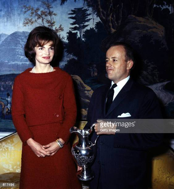 First Lady Jacqueline Kennedy poses for a photograph with James Hoban Alexander at the White House December 5 1961 in Washington DC