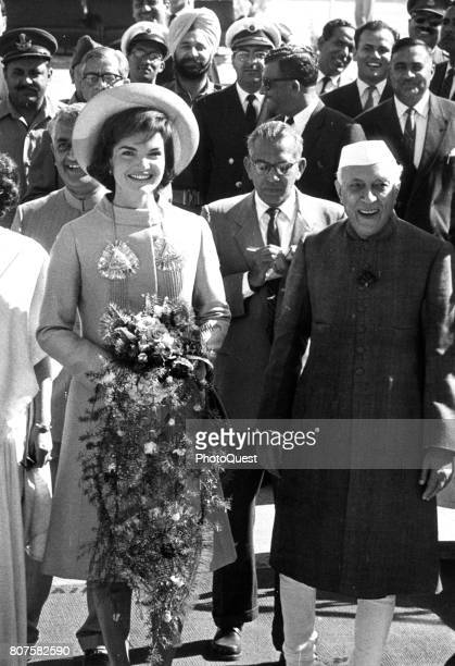 US First Lady Jacqueline Kennedy poses with Indian Prime Minister Jawaharlal Nehru at Palam Airport during the former's State Visit Delhi India March...