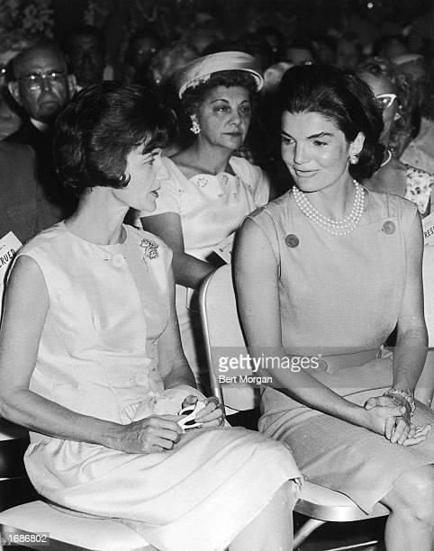First Lady Jacqueline Kennedy sits in an audience beside American socialite Jayne Wrightsman at the Hotel Biltmore Palm Beach Florida March 1961
