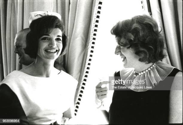 US First Lady Jacqueline Kennedy speaks with an unidentified woman at a reception London England June 6 1961 The event held in the home of Princess...