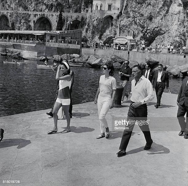 First Lady Jacqueline Kennedy spending a twoweek vacation in Ravello with daughter Caroline walks with sister Lee Radziwill and Italian auto...