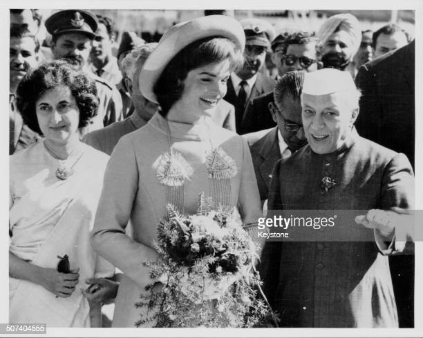 First Lady Jacqueline Kennedy with Indian Prime Minister Nehru and his daughter Indira, at Palam Airport, India, March 16th 1962.