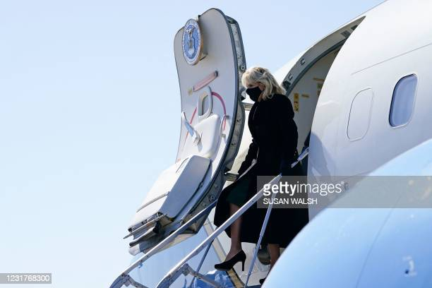 First Lady Jill Biden arrives at ManchesterBoston Regional Airport in Manchester, New Hampshire, on March 17, 2021. - Biden is promoting the $1.9...