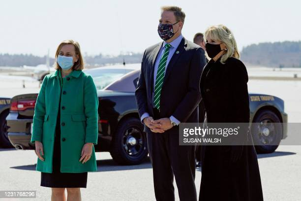 First Lady Jill Biden is welcomed by New Hampshire Governor Chris Sununu and Manchester, New Hampshire, Mayor Joyce Craig after arriving at...