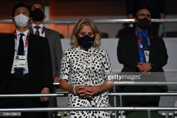 First Lady Jill Biden observes a moment of silence during the opening ceremony of the Tokyo 2020 Olympic Games, at the Olympic Stadium in Tokyo, on...