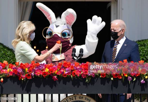 First Lady Jill Biden presents a flower to the Easter Bunny , alongside US President Joe Biden after Biden spoke about the Easter holiday and the...