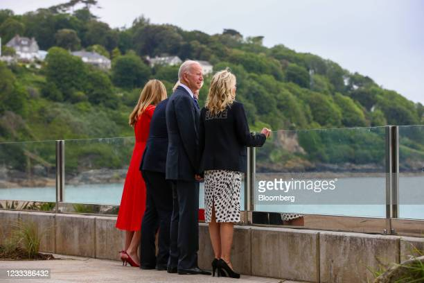 First Lady Jill Biden, right, Carrie Johnson, wife of U.K. Prime minister Boris Johnson, left, and Boris Johnson, U.K. Prime minster, second left,...