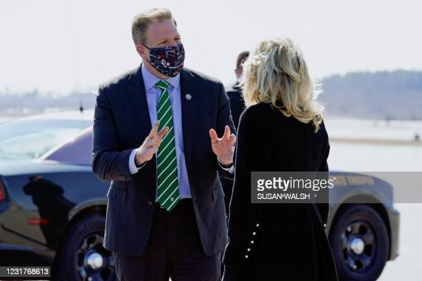 First Lady Jill Biden speaks with New Hampshire Governor Chris Sununu after arriving at ManchesterBoston Regional Airport in Manchester on March 17,...