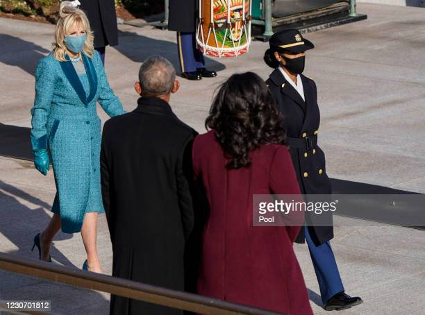 First lady Jill Biden walks past former President Barack Obama and Michelle Obama for a ceremony at the Tomb of the Unknown Soldier Arlington...