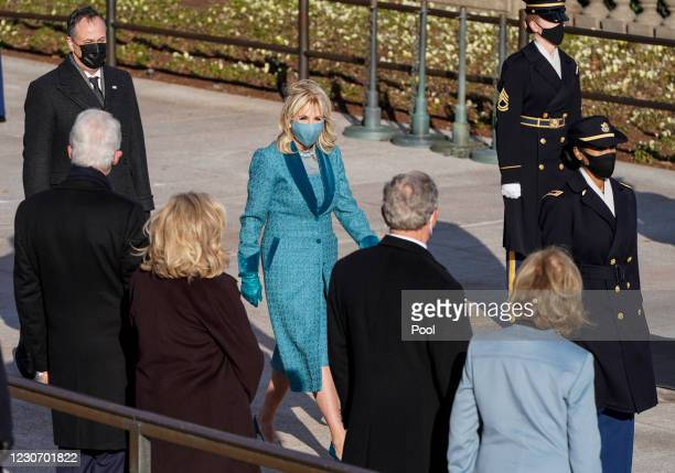 First lady Jill Biden walks past former President Bill Clinton, Hillary Clinton, former President George W. Bush and Laura Bush for a ceremony at the...