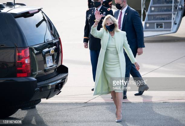 First Lady Jill Biden waves after arriving at Delaware Air National Guard Base in Wilmington, Delaware, March 12 as they travel to their home state...