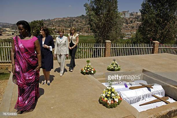 First Lady Laura Bush accompanied by her daughter Jenna tour with Cherie Blair, wife of British Prime Minister Tony Blair, the Gisozi Genocide...