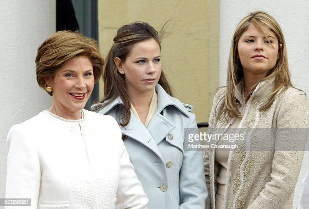 First lady Laura Bush and her daughters Barbara and Jenna stand outside St John's Episcopal Church after attending a Church service with US President...