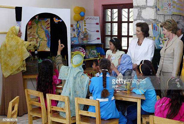 First Lady Laura Bush and her Egyptian counterpart Suzanne Mubarak listen to a girl describing the Nile river's strategic importance to Egypt 23 May...