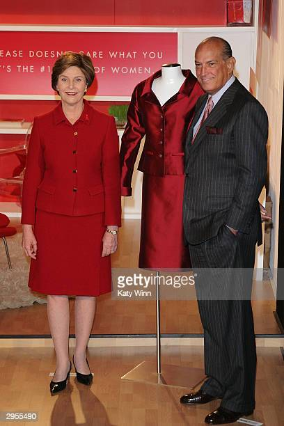 First lady Laura Bush and Oscar de la Renta attend a ceremony unveiling an Oscar de la Renta dress donated to the Spring Fashion 2004 Heart Of Truth...
