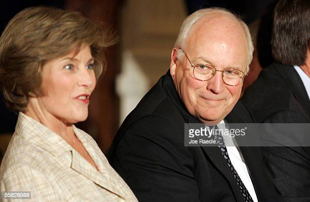 First lady Laura Bush and US Vice President Dick Cheney attend the swearing in ceremony of John Roberts as the new Chief Justice of the US in the...