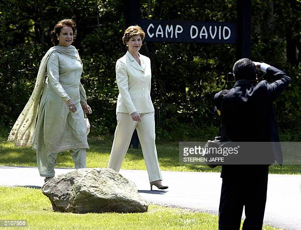 US First Lady Laura Bush escorts Sehba Musharraf to their hubands' joint press conference at Camp David 24 June 2003 in Maryland Bush hosted...