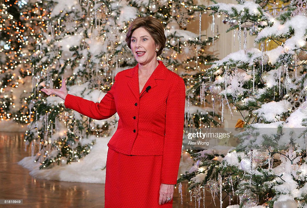 U s first lady laura bush gestures as she reveals the white house christmas decorations during a