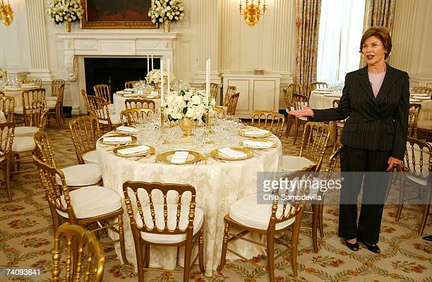 First lady Laura Bush hosts a preview of the place settings for the dinner honoring Queen Elizabeth II in the State Dining room on the State Floor of...