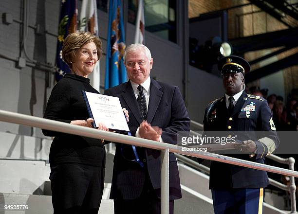First lady Laura Bush receives the Secretary of Defense award for Outstanding Public Service from Robert Gates US secretary of defense during the...