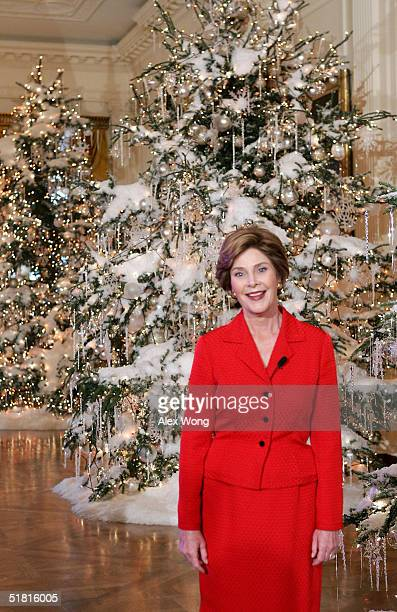 S first lady Laura Bush reveals the White House Christmas decorations during a press preview at the White House December 2 2004 in Washington DC The...