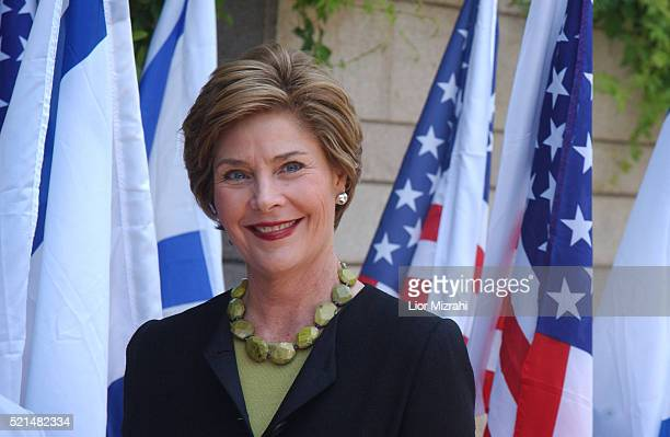 First lady Laura Bush smiles after being greeted by Gila Katzav, the wife of Israeli President Moshe Katzav, at the president house in Jerusalem...