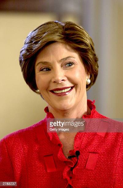 First lady Laura Bush smiles as she unveils the 2003 White House Christmas decorations in the State Dining Room of the White House December 4 2003 in...