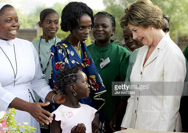 First Lady Laura Bush smiles at eightyearold Bukky as she is introduced by her aunt Toyin Yomi a 26 yearold who tested positive for HIV in 1999...