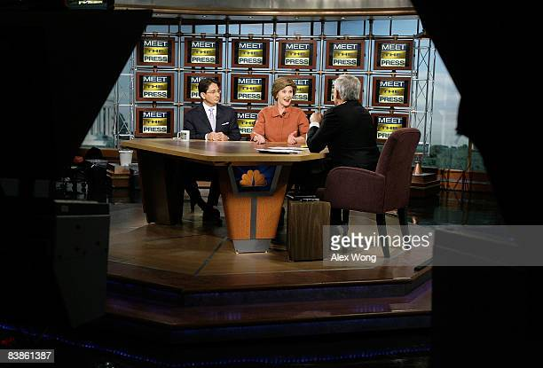US First lady Laura Bush speaks to host Tom Brokaw as Ambassador of Afghanistan to the United States Said Jawad listens during a taping of 'Meet the...