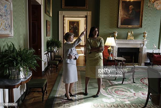 First Lady Laura Bush takes Michelle Obama for a private tour of the artwork in the East wing of the White House during a coffee morning with...