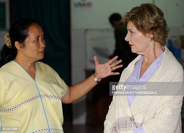 US First Lady Laura Bush talks with Doctor Cynthia Maung during a visit to The Mae Tao Clinic in Mae Sot on August 7 2008 The First Lady visited a...