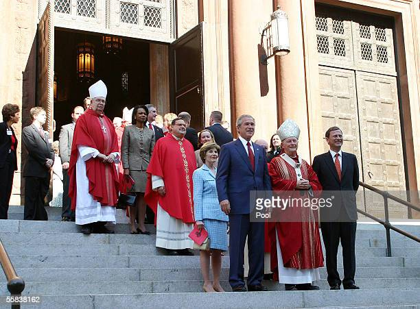 First lady Laura Bush US President George W Bush Cardinal Theodore McCarrick Archbishop of Washington and new Chief Justice John Roberts stand on the...
