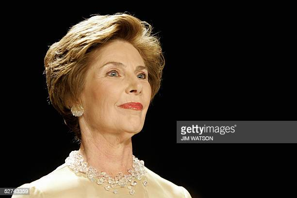 First Lady Laura Bush watches the honor guard march past at the beginning of the annual dinner of the White House Correspondents' Association 30...
