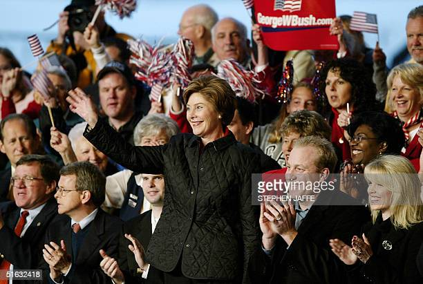 First Lady Laura Bush waves to the crowd next to World Series Champsionship winner Boston Red Sox pitcher Curt Schilling during a campaign rally at...