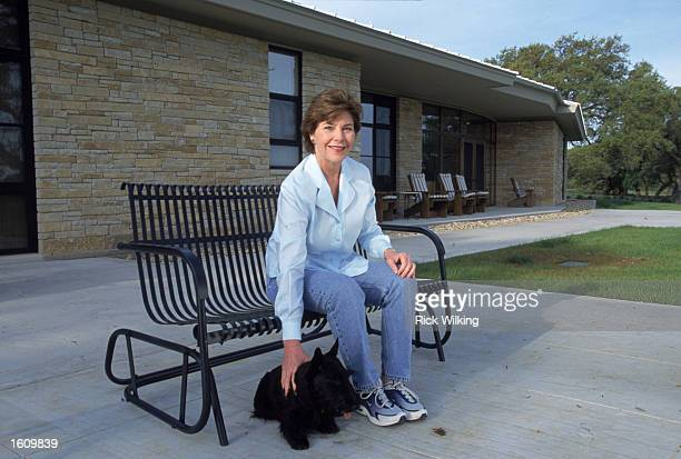 First Lady Laura Bush wife of President George W Bush is relaxing on a bench with her dog Barney April 11 2001 on the patio outside of the house at...