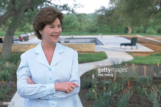 First Lady Laura Bush wife of President George W Bush is standing in her garden next to the house April 11 2001 at their Prairie Chapel Ranch in...