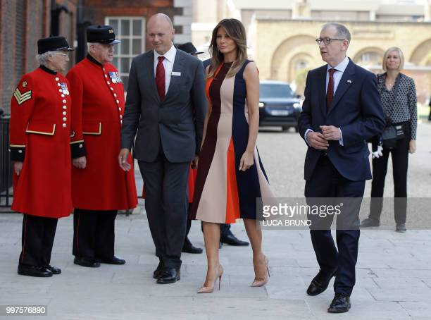 US First Lady Melania Trump accompanied by the British prime minister's husband Philip May arrives to visit the Royal Chelsea Hospital in London on...